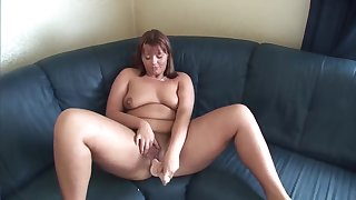 Honcho Redheaded Euro MILF toys both holes on her couch