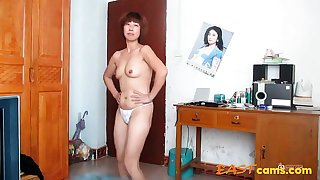 chinese superannuated woman blinking
